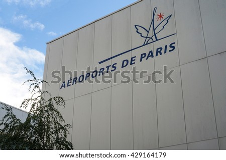 Charles de Gaulle International Airport (Paris, France) Terminal 2G external view and Airport logo. Paris, France - September 22, 2015. - stock photo