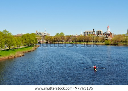 Charles River in the spring. People rowing, jogging, walking� Harvard University buildings in the background. - stock photo