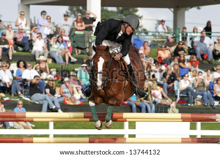 Charlie Jayne of Elgin, Illinois – 2006 Maxine Beard Show Jumping Developing Rider Award winner and 2008 USA Olympic Show Jumping hopeful – rides Urbanus in Colorado in 2007 (editorial image). - stock photo