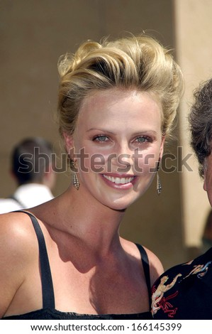 Charlize Theron at the induction ceremony for Star on the Hollywood Walk of Fame for Charlize Theron, Hollywood Boulevard, Los Angeles, September 29, 2005