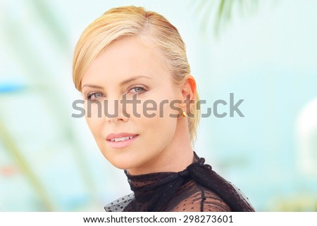 Charlize Theron attends the 'Mad Max : Fury Road' Photocall during the 68th annual Cannes Film Festival on May 14, 2015 in Cannes, France. - stock photo