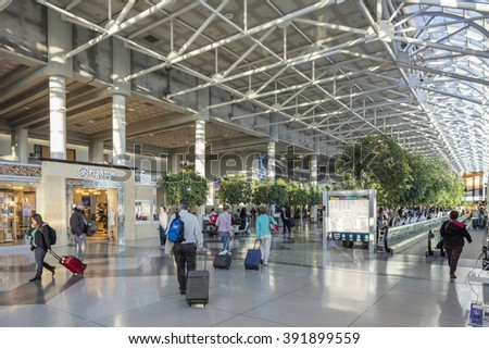 CHARLOTTE - MARCH 16th, 2016: Interior of Charlotte Douglas International Airport. The Airport is a joint civil-military public international airport located in Charlotte, NC, United States. - stock photo