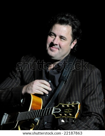 CHARLOTTE, NC - DEC 16 2008. Amy Grant and Vince Gill perform a live Christmas concert onstage at Ovens Auditorium celebrating the 70th anniversary of the Charlotte Rescue Mission