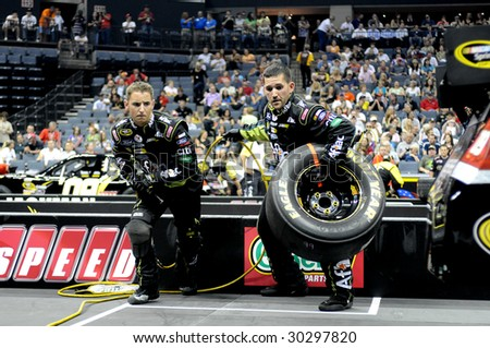CHARLOTTE, NC - MAY 14: Aflac pit crew team rear tire wranglers Brandon Hopkins and Jody Fortson team up in the NASCAR Pit Crew Challenge at Time Warner Cable Arena on May 14, 2009 in Charlotte, NC. - stock photo