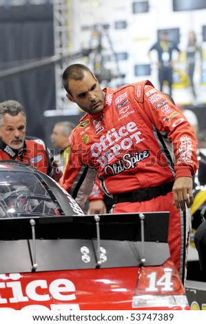 CHARLOTTE, NC - MAY 19: crew members of the number 14 Office Depot car back the car up to the starting line in  the 2010 NASCAR Pit Crew Challenge MAY 19 2010 in CHARLOTTE NC - stock photo