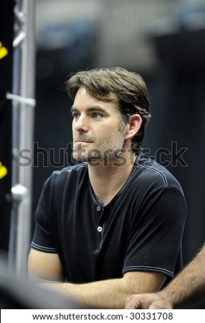 CHARLOTTE, NC - MAY 14: NASCAR driver Jeff Gordon watches in anticipation as his number 24 Dupont team competes in the NASCAR Pit Crew Challenge at Time Warner Cable Arena on May 14, 2009 in Charlotte, NC. - stock photo