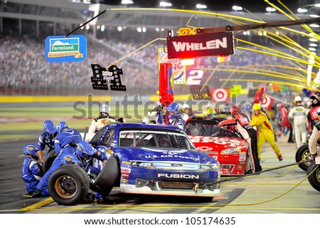 CHARLOTTE, NC - MAY 27:   pit stops for Aric Almirola (blue) and Tony Stewart at the Nascar Coca Cola 600  at Charlotte Motorspeedway in Charlotte, NC on May 27, 2012 - stock photo