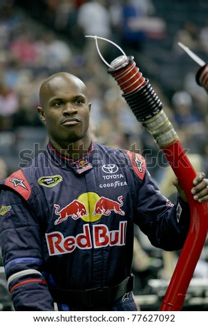 CHARLOTTE, NC - MAY 19: Red Bull gas man Mike Metcalf prepares for his round during the 2011 NASCAR Pit Crew Challenge at Time Warner Cable Arena in Charlotte, NC on May 19 2011 - stock photo