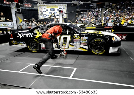CHARLOTTE, NC - MAY 19:  Tax Slayer.com jackman Jeff Kerr is a blur of speed during the 2010 NASCAR Pit Crew Challenge  MAY 19 2010 in CHARLOTTE, NC - stock photo