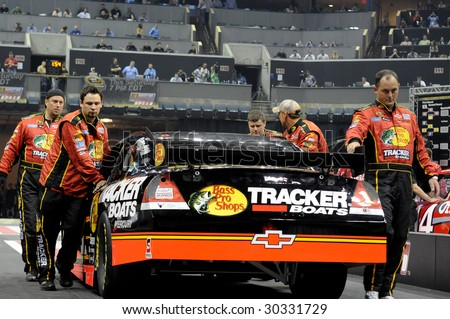 CHARLOTTE, NC - MAY 14: The Bass Pro Shops team pushes their car to the starting line for the next event in the NASCAR Pit Crew Challenge at Time Warner Cable Arena on May 14, 2009 in Charlotte, NC.