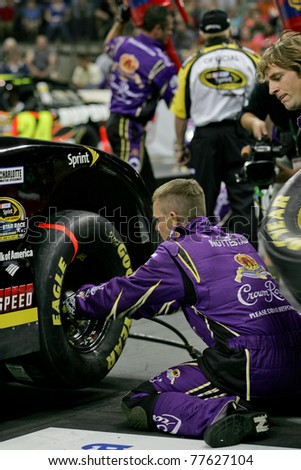 CHARLOTTE, NC MAY 19: The No. 17 Crown Royal front tire changer Justin Nottestad  changes the front tire in the 2011 NASCAR Pit Crew Challenge at Time Warner Cable Arena in Charlotte, NC on May 19 2011 - stock photo