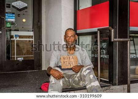 Charlotte, NC, USA - August 16, 2015: A homeless veteran who was looking for a miracle.
