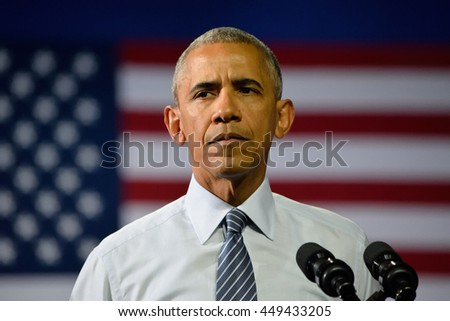 CHARLOTTE, NC, USA - JULY 5, 2016: President Barack Obama with the face of concern as he speaks at a campaign rally for the presumptive democratic nominee at the Charlotte Convention Center. - stock photo