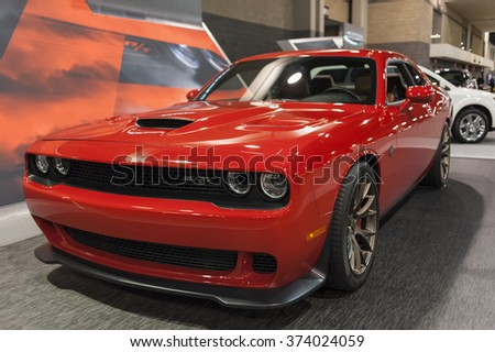CHARLOTTE, NC, USA - November 11, 2015: Dodge Challenger SRT Hell Cat on display during the 2015 Charlotte International Auto Show at the Charlotte Convention Center in downtown Charlotte. - stock photo