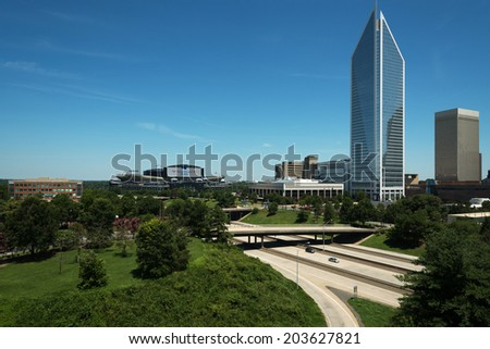 CHARLOTTE, NORTH CAROLINA - JULY 5, 2014:  View of the Charlotte, North Carolina downtown skyline including the newly renovated Bank of America Stadium, Duke Energy Center and the Charlotte Observer. - stock photo