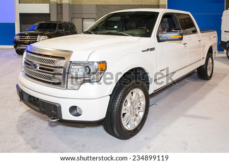 CHARLOTTE, NORTH CAROLINA - NOVEMBER 20, 2014: Ford F150 pickup truck on display during the 2014 Charlotte International Auto Show at the Charlotte Convention Center. - stock photo