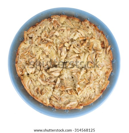 Charlotte pie with apples on a plate, isolated on a white background - stock photo