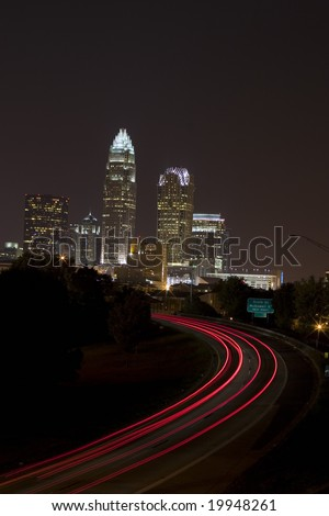 Charlotte Skyline with traffic in the foreground - stock photo