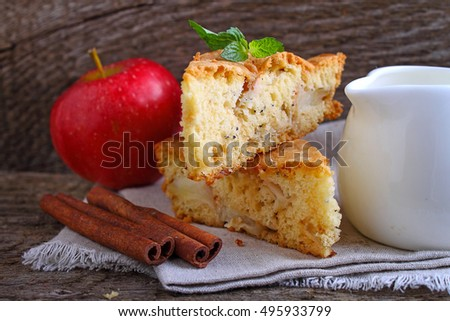 Charlotte with apples in the white plate on a wooden background