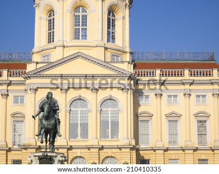 Charlottenburg Palace and the statue of Friedrich Wilhelm I elector of Brandenburg, Berlin, Germany. This largest palace in Berlin was built at the end of the 17th century. - stock photo