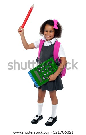 Charming African school kid is all set to attend school. - stock photo