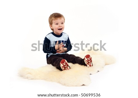 charming and expresiive child portrait studio isolated backgroun - stock photo