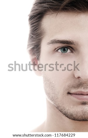 Charming and handsome man half face close up - stock photo