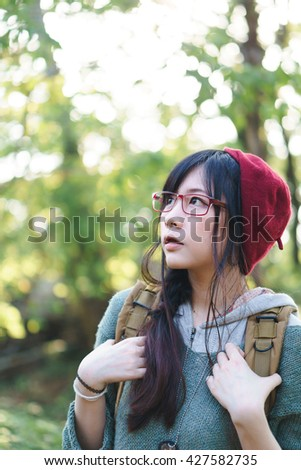 Charming Asian girl in the park
