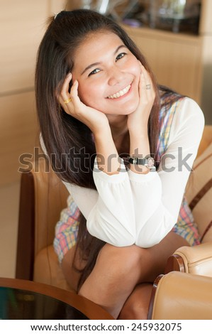 Charming asian woman Smile face close up and she sitting on the sofa in coffee shop - stock photo