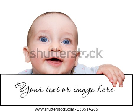 Charming babe looking and smiles holding a signboard - stock photo