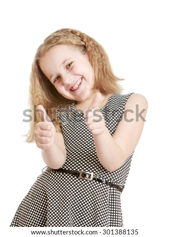 Charming blond girl with short bushy hair shows all okay hand sign. On the girl wearing a gray silk gown tied with a strap.-Isolated on white background - stock photo