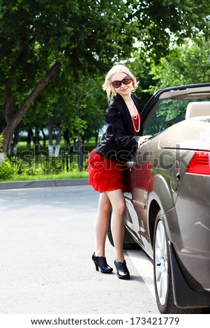 charming blonde and the car