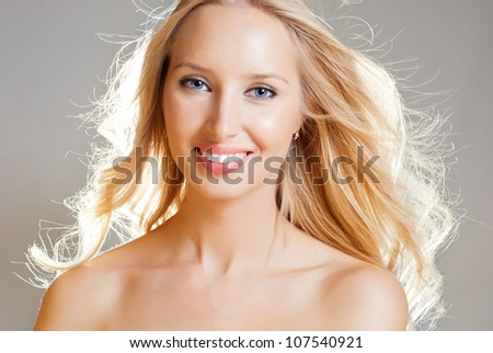 Charming blonde girl's face - stock photo