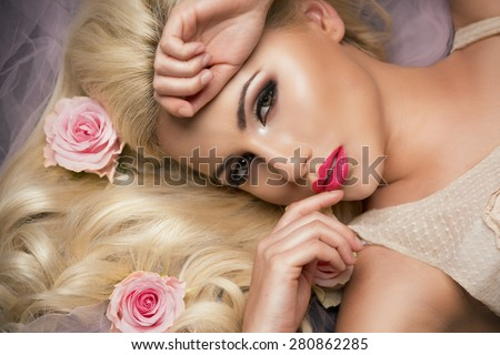 Charming blonde girl with a flowers.  Woman with beautiful face.   - stock photo