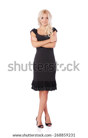 Charming blonde in dark dress, isolated on white background.