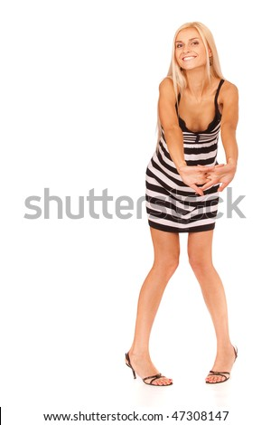 Charming blonde in striped dress to utmost, it is isolated on white background.