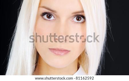 Charming blonde, isolated on black background. - stock photo