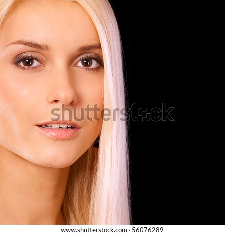 Charming blonde, it is isolated on black background. - stock photo