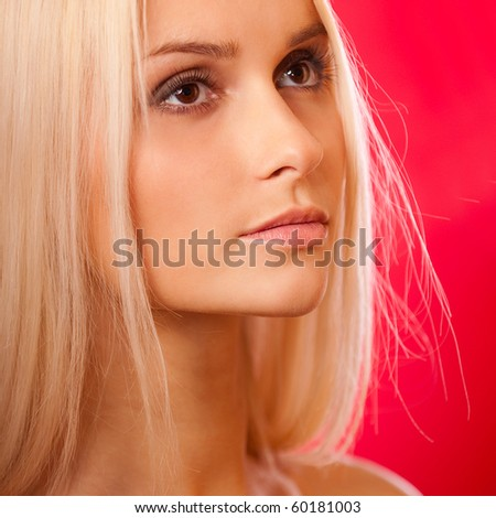 Charming blonde on red background.