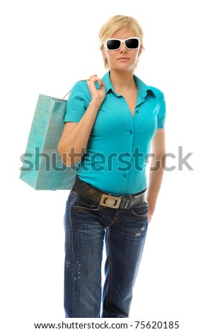Charming blonde woman with a shopping bag. Isolated on white background - stock photo