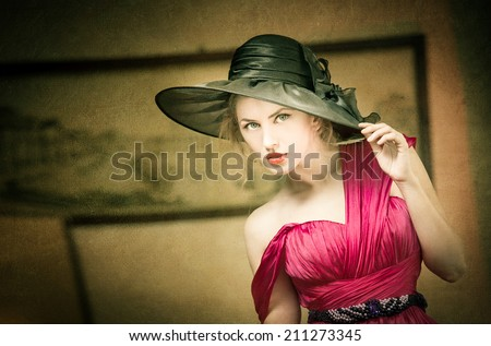 Charming blonde woman with black hat, retro image. Young beautiful fair hair female posing vintage. Mysterious lady with movie star look. Attractive fashionable girl looking as an American actress  - stock photo