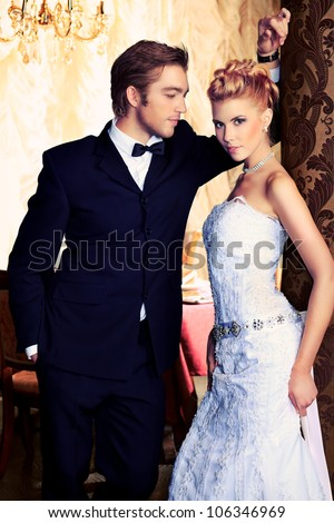 Charming bride and groom on their wedding celebration in a luxurious restaurant. - stock photo