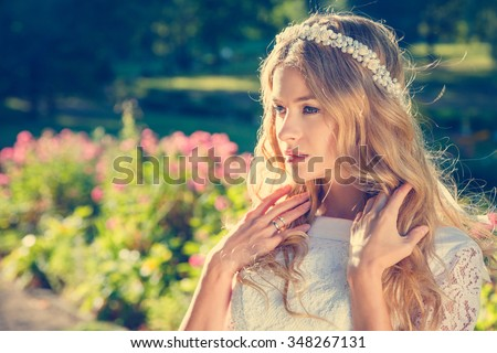 Charming Bride with Wedding Tiara on Nature Background. Modern Bridal Style. Toned Photo with Copy Space. - stock photo