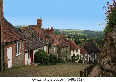 Charming British Village overlooking countryside. - stock photo