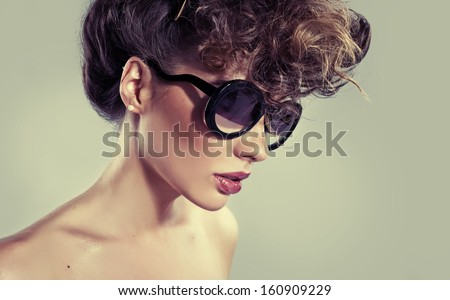 Charming brunette wearing sunglasses - stock photo