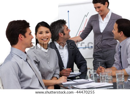Charming businesswoman giving a presentation to her team