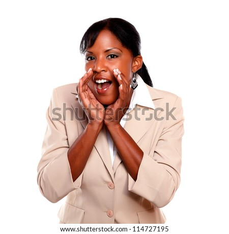Charming businesswoman screaming at you on isolated background - stock photo