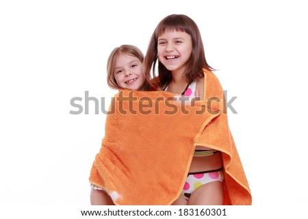 Charming caucasian little girl in swimsuit holding orange towel isolated over white backgroundadorable little girls in swimsuit holding orange towel  - stock photo