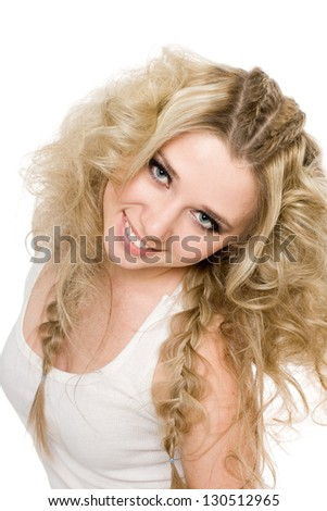 Charming cheerful young blond girl with curly hair and stylish make-up.