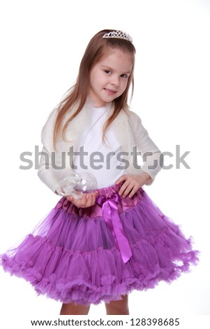 Charming child dressed in bright festive clothes on a white background